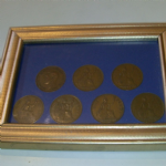 1937-1945 United Kingdom One Penny pieces mounted in frame